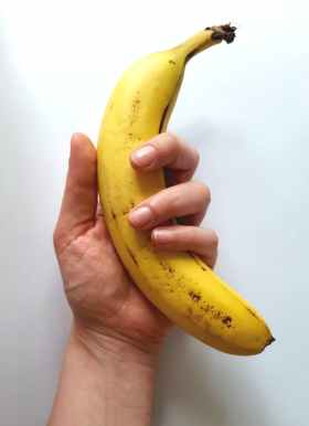 yellow banana on hand